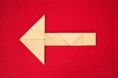 Flecha que muestra la dirección Imagen de archivo