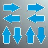Flechas azules en diversas direcciones con una textura y fuera Foto de archivo libre de regalías