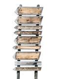 Flechas de madera rústicas múltiples en un poste indicador Imagenes de archivo