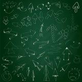 Flechas dibujadas mano de la colección en la pizarra Fotografía de archivo