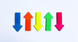 Flechas en los colores de neón Imagen de archivo libre de regalías