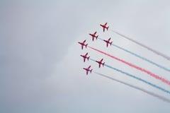Flechas rojas, conocidas oficialmente como el equipo aeroacrobacia de Royal Air Force Imagen de archivo