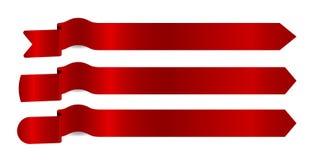 Flechas rojas de las cintas Fotos de archivo libres de regalías