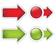 Flechas y botones rojos y muestra verde Imagen de archivo