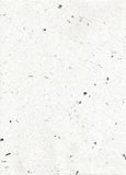 Flecks of Speckled Fiber Paper. Textural white paper speckled with black fibers Stock Photos