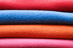 Fleece. Stack of colorful fleece cloths Royalty Free Stock Images
