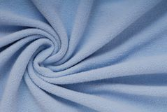 Fleece textile, beautiful shape, blue cloth, soft material, text. Ures, texturing backgrounds Royalty Free Stock Images