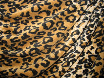 Fleecy brown draped leopard skin fabric Stock Images