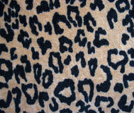Fleecy brown leopard skin fabric background Stock Photography