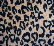 Fleecy brun bakgrund för leopardhudtyg Arkivbild