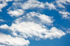 Fleecy clouds on blue sky Stock Photos