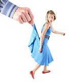 Fleeing woman. Who is held by big hand Stock Photos