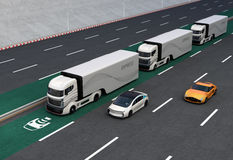Fleet of autonomous hybrid trucks driving on wireless charging lane. 3D rendering image stock illustration