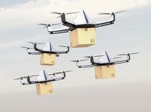 Fleet of autonomous unmanned drones delivering cardboard box in the sky Royalty Free Stock Photos