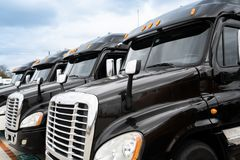Fleet of black 18 wheeler semi trucks stock image