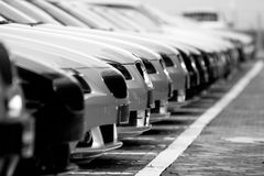 Fleet of cars. Row of cars in a car park, focus on the closest one