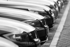 Fleet of cars. Row of cars in a car park, focus on the closest one stock photography