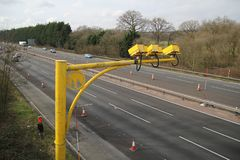 Fleet, Hampshire, UK - March 11th 2017: Average speed cameras in operation on the M3 Motorway to reduce vehicle speed to safe limi. Ts in roadworks stock image