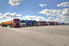 Fleet of lorries with trailer in courtyard of logistics terminal. St. Petersburg, Russia - July 27, 2017: Fleet of lorries, a lot of lorries parked in the yard stock photo