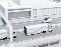 A fleet of self-driving electric semi trucks driving on highway Stock Photography