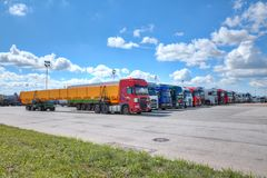 Fleet of semi trailer lorries in courtyard of logistics park. stock photography