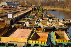 Fleet of special barges for deepening of channels. Ships of ensuring engineering works on channel cleaning Stock Images