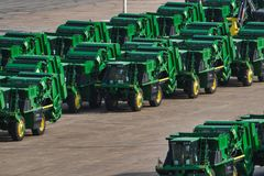 Fleet of tractors lined up in a shipping yard stock images