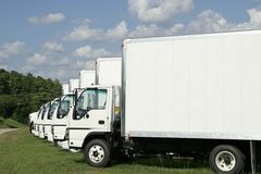 Fleet of Trucks. A fleet of single axle cargo Trucks royalty free stock photography