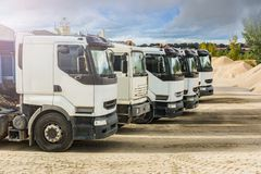 Fleet of vehicles to transport river sand in a mine.  stock images