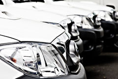 Fleet of White Cars and trucks Stock Photo