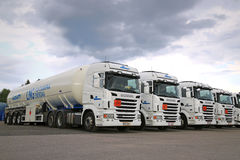 Fleet of White Scania Semi Tank Trucks. RAJAMAKI, FINLAND - JULY 2, 2016: Fleet of white Scania R480 semi tank trucks with ADR plates for Liquefied natural gas stock photos
