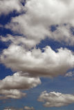 Fleeting clouds. An image of a series of cloud on a clear morning sky stock images