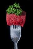 Fleisch auf einer Gabel Stockfoto