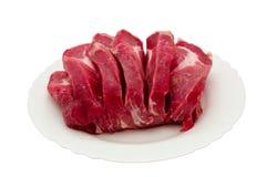 Fleisch auf weißer Platte. Lizenzfreies Stockfoto