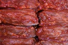 Fleisch in der Marinade Stockfotos