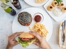 Fleisch fressende Burger Stockbild