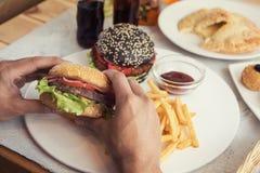 Fleisch fressende Burger Stockfotografie