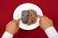 Fleisch fressende Zigarettenkippen Stockfotografie