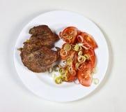 Fleisch mit Tomaten Stockfoto