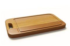 Fleisch-Tenderizer auf hölzernem Brett auf Weiß backgroundwooden Platte für das Fleisch und hölzernes GemüseSchneidebrett, die an Stockbilder