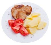 Fleisch und Gemüse auf Platte stockbild