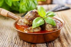Fleischklöschen in der Tomatensauce Lizenzfreie Stockbilder