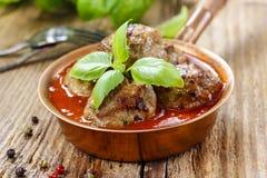 Fleischklöschen in der Tomatensauce Stockfotografie