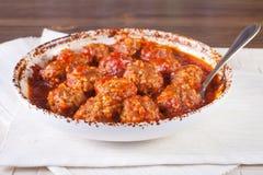 Fleischklöschen in der Tomatensauce Lizenzfreie Stockfotos