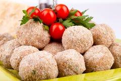 Fleischklöschen und Cherry Tomatoes Lizenzfreie Stockfotografie