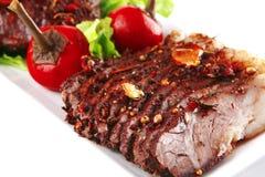 Fleischsteak auf Platte Stockbild
