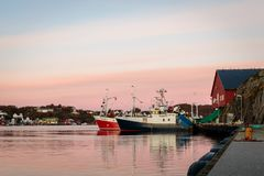 Flekkeroya, Kristiansand in Norway - October 27, 2017: Fishing boats at pier by the seine factory at Geiteroya. stock images