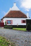 Flemish polder farmhouse. Typical flemish polder farmhouse in a good state of repair, painted white and red, Belgium, Europe Stock Image