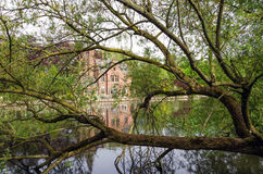 Flemish style building in Minnewater lake, Fairytale scenery in. Bruges, Belgium royalty free stock photos