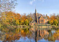 Flemish style building reflecting in Minnewater lake, Bruges Stock Image
